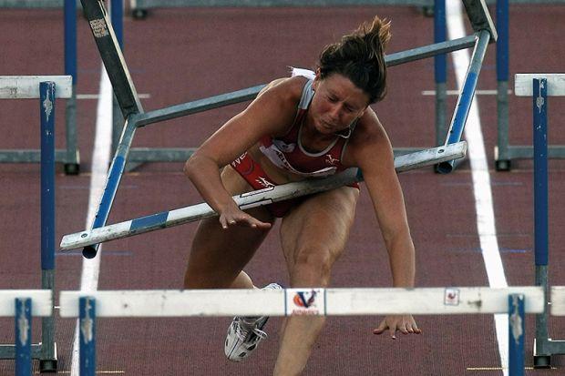 Hurdler runs into hurdle