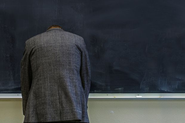 teacher frustrated at blackboard