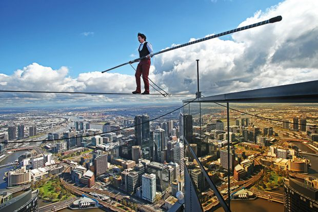 High-wire artist Kane Petersen successfully walks a tightrope 300 metres above the ground at Eureka Skydeck in Melbourne, Australia.