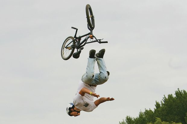 A BMX rider falls as he competes in the National Adventure Sports Show in Shepton Mallet, Somerset, south west England