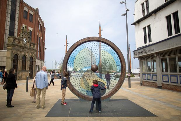 Pedestrians look at the The Keel Line memorial, built to remember Sunderland's shipping industry in Sunderland, U.K