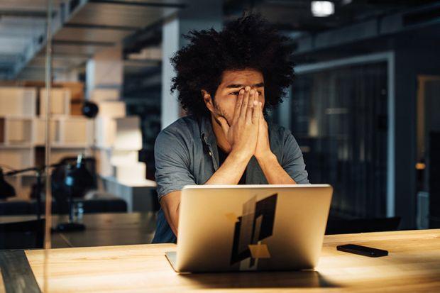 Black student at laptop