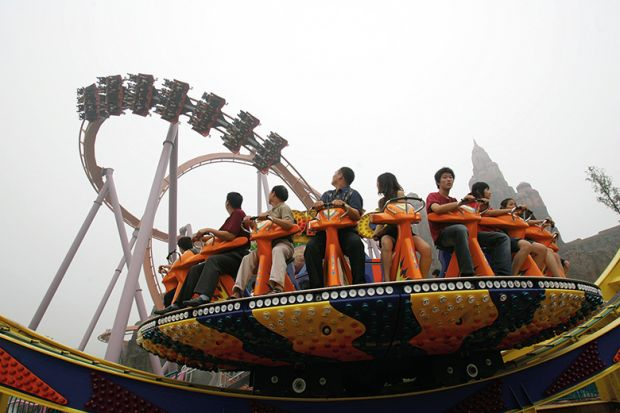 Tourists enjoy the amusement facilities at Chinese Theme Park, Beijing of China