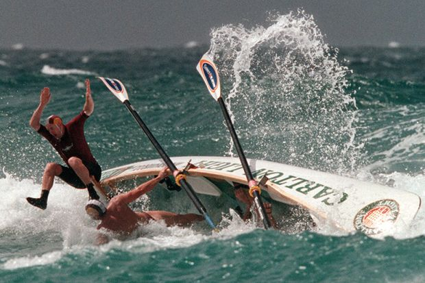 Boat crew come to grief during the Semi Finals of the Open Boat Race, Kurrawa Beach, Surfers ParadIse, Australia