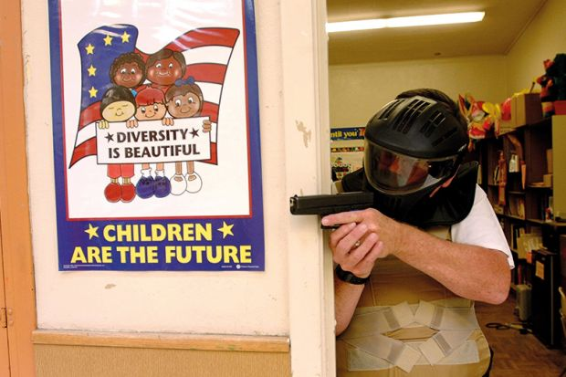 Police training exercise with gun and diversity poster