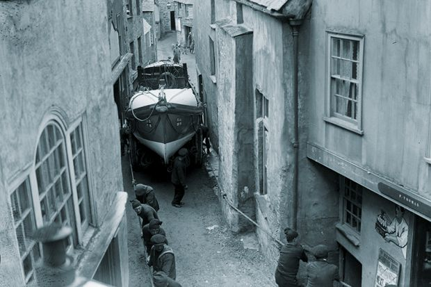 The Port Isaac Cornwall lifeboat being dragged through the very narrow streets of the town at its launch.