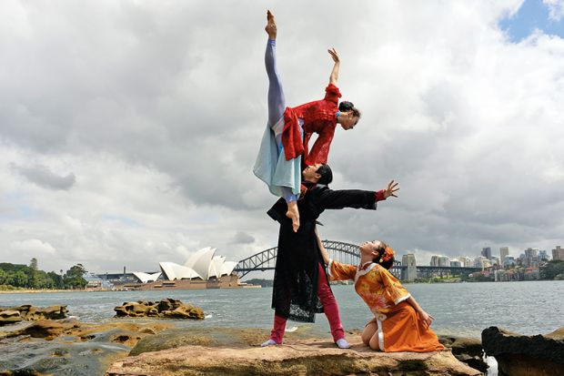Performers from a Chinese ballet company perform in front of the Australia's iconic landmarks Opera House and Harbour Bridge in Sydney