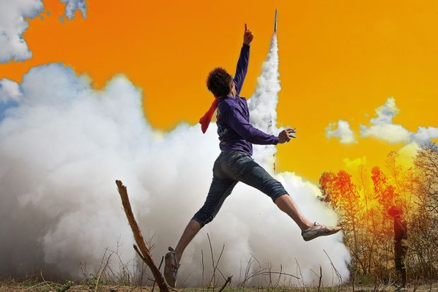 Person jumping in the air as a rocket takes off