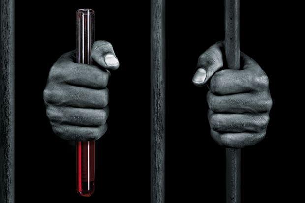 Prisoner holding bars and a test tube