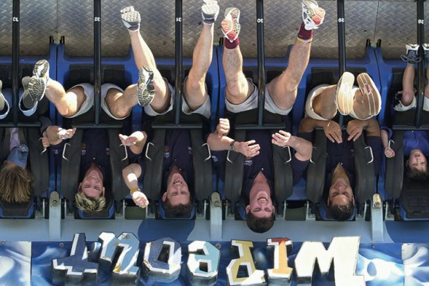 People are thrown upside down while riding the Wipeout at Dreamworld on the Gold Coast, Australia