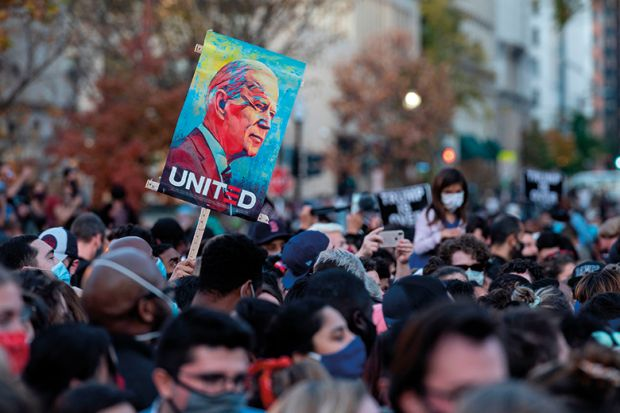 People celebrate at Black Lives Matter Plaza across from the White House in Washington, DC on November 7, 2020, after Joe Biden was declared the winner of the 2020 presidential election