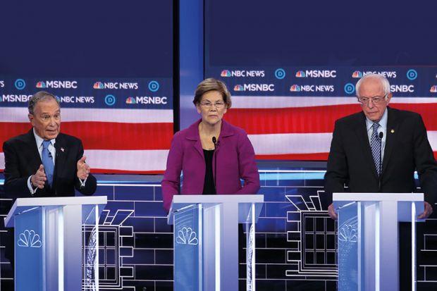 Democratic presidential candidate former New York City Mayor Mike Bloomberg, speaks as Sen. Elizabeth Warren (D-MA) and Sen. Bernie Sanders (I-VT) listen during the Democratic presidential primary debate at Paris Las Vegas on February 19, 2020.