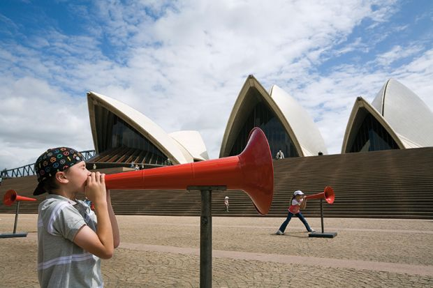 Kids shout through megaphones at the Opera House during the Sydney Festival. Australia