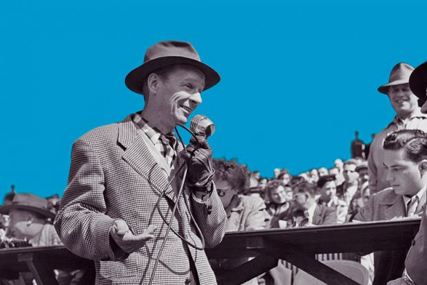 A man wearing a hat speaks into a microphone addressing the crowd gathered behind him, USA, circa 1950.