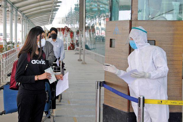 Checking passports during the coronavirus pandemic