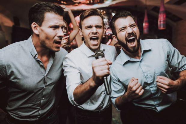 Three men singing