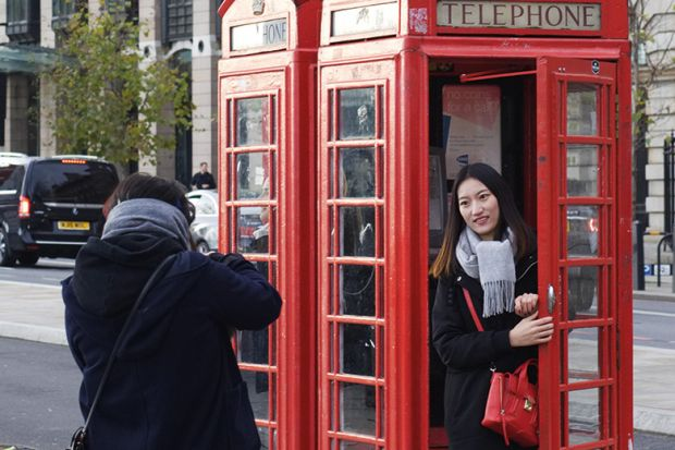 Tourist in a phone box