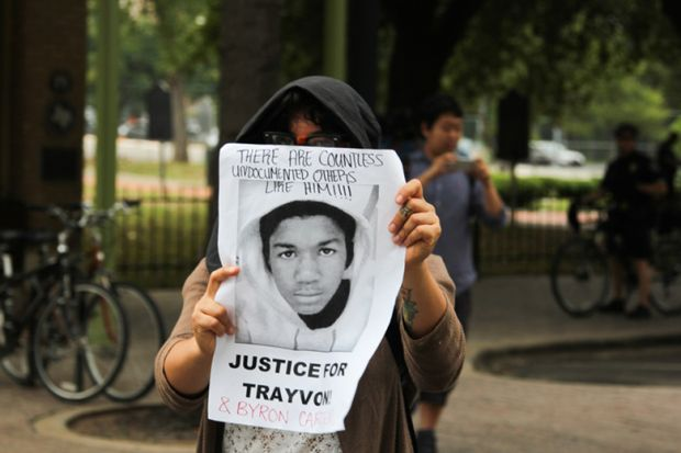 Woman Holds 'Justice for Trayvon' Poster in Austin, Texas