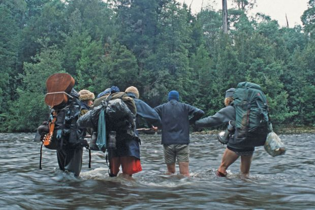 Trekkers crossing river, Tarkine rainforest