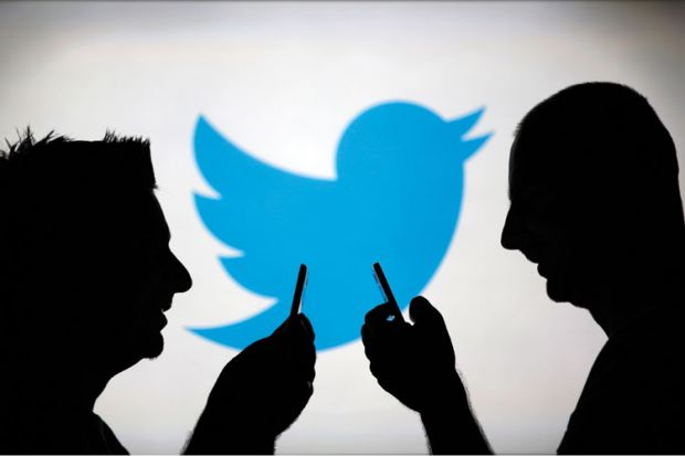 Men using smartphones against Twitter backdrop