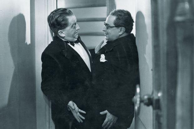Two men stuck in doorway