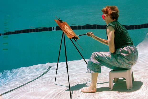 Woman painting underwater