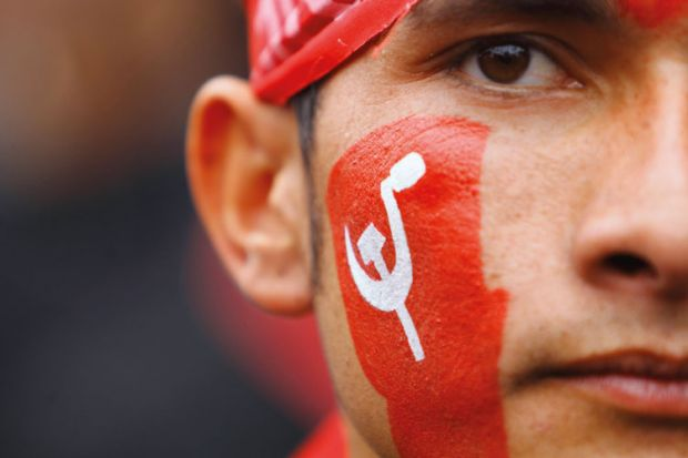 Unified Communist Party of Nepal supporter with painted face