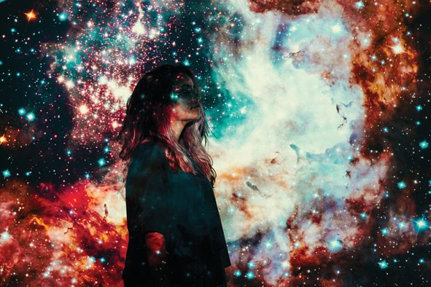 woman against a background of a starry sky