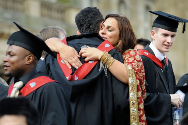 University graduates hugging and celebrating