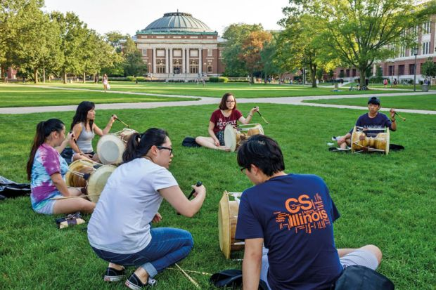 University of Illinois at Urbana-Champaign students playing drums