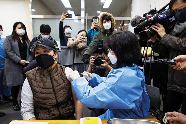 Media documents a nurse administering the AstraZeneca Covid-19 vaccine at a public health centre in Incheon, South Korea, in February 2021