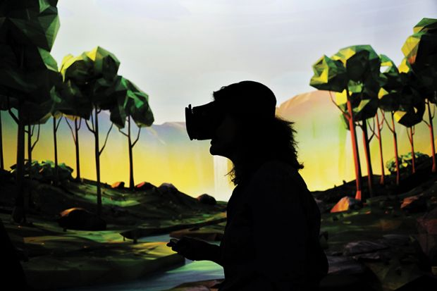 """A woman tries on Google's virtual reality device """"Daydream View"""" after the opening of Google's pop-up store in New York, 2016"""