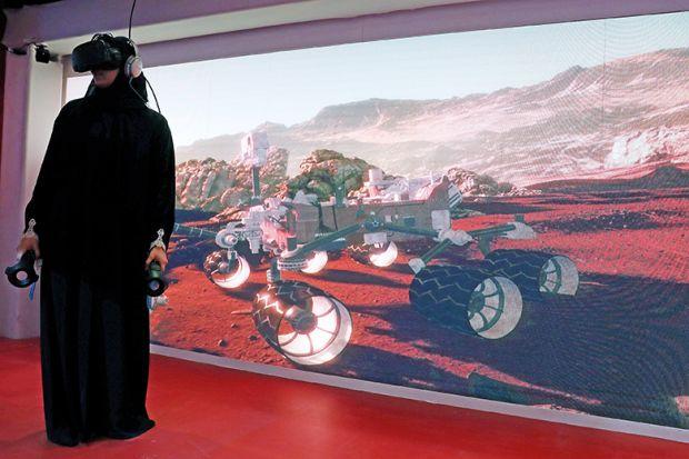 Muslim woman wears VR headset