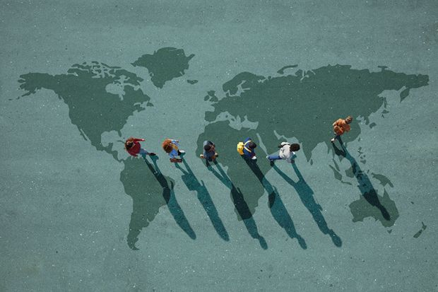 people walking on a world map