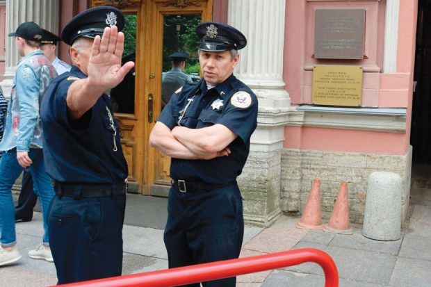 Security officers stand guard outside the US Consulate in Saint Petersburg