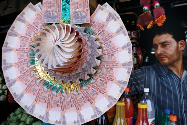 Display of a garland made of Indian currency notes to illustrate Increasing academic salaries must be a priority if India's new independent research funder is to turbocharge science.