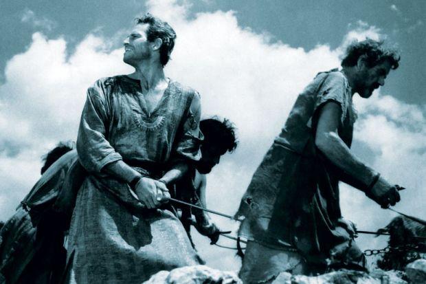 Film still of Ben Hur who has fallen into slavery as a metaphor for universities refuse to 'slavishly follow' teacher training plans