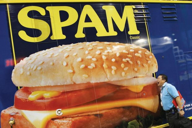 Poster of Spam with person pretending to eat it as a metaphor for  UUK 'should sue predatory publishers over tsunami of spam'