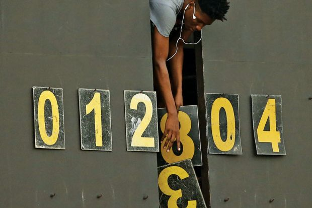 Scoreboard operator dropping numbers as a metaphor for University 'fudging figures' on sociology cuts