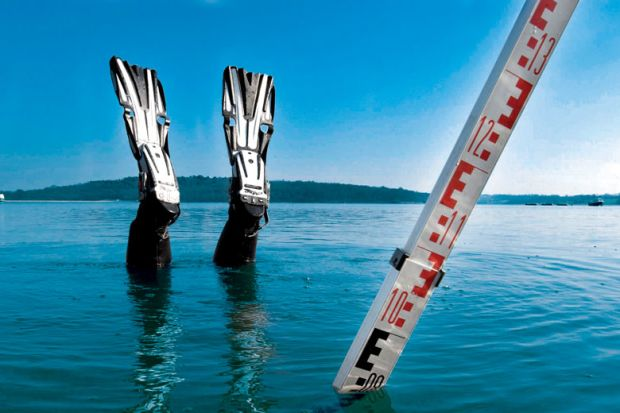Divers feet and a measure stick showing above water level only as a metaphor for Journal impact factor ban is bad for Dutch science