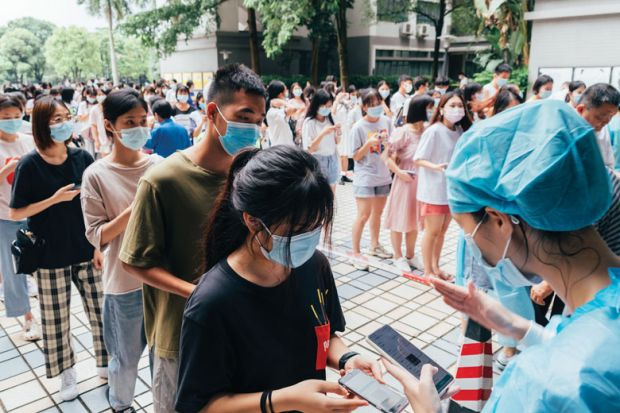 Students queue up for nucleic acid test at Guangdong University of Foreign Studies as they are mentioned in the copy.
