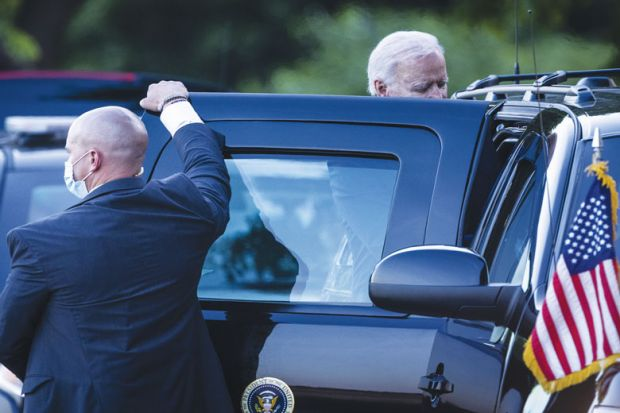 U.S. President Joe Biden gets into a vehicle with a person holding the door as a metaphor for Biden push for innovative NIH raises concern in Congress