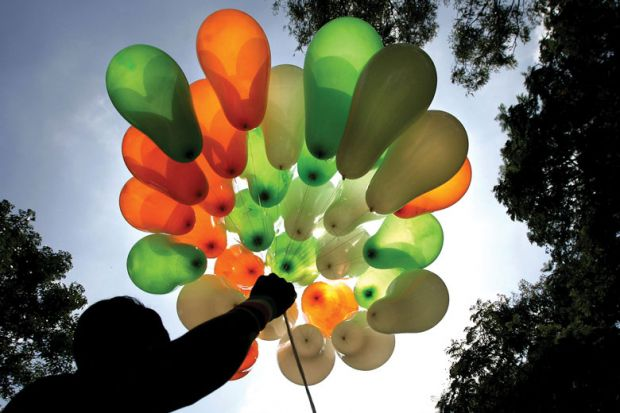 A vendor displays his stock of balloons in the tri-colours of the national flag on a street in Bangalore.
