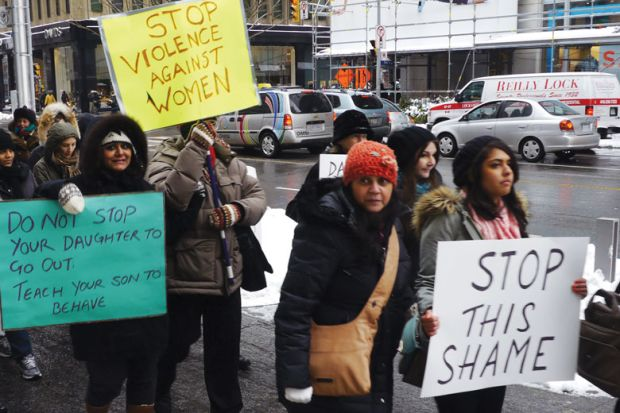 Woman, many of them of South-Asian origin, demonstrate in Toronto, Ontario to illustrate US and Canadian students protest over sexual assaults