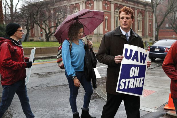 U.S. Representative Joe Kennedy lll walks the picket line with Harvard University graduate students to illustrate US colleges hit by wave of student labour unionization