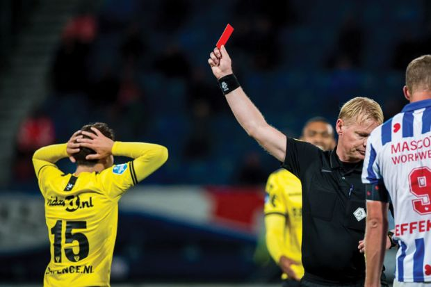 Referee  gives a red card  during the Dutch Eredivisie match