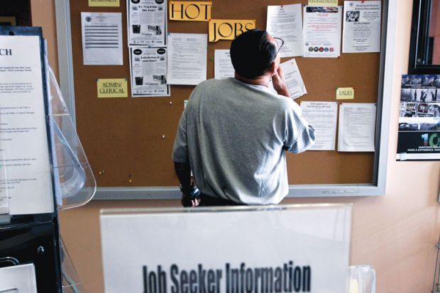 A job seeker looks at postings for jobs at the Verdugo Jobs Center, which includes a California Employment Development satellite office