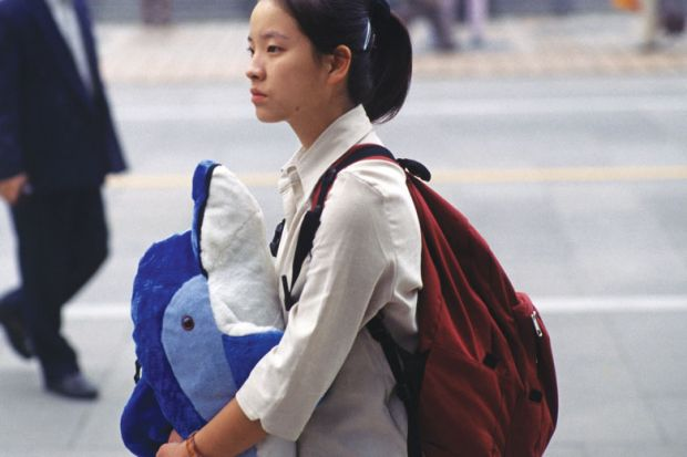 Chinese lady holding toy whale