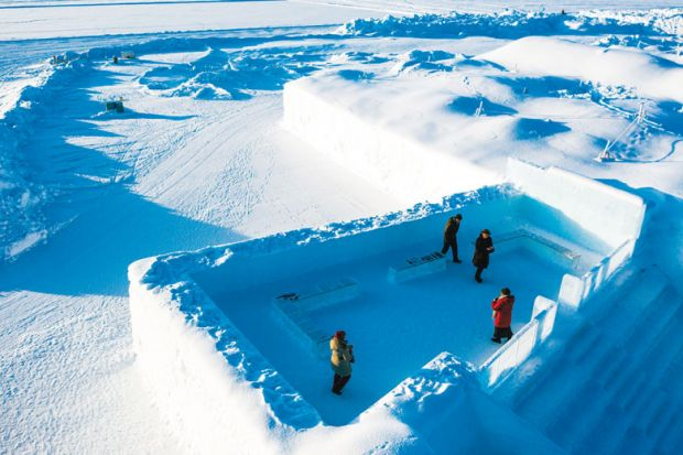 Ariel view of The Ice Hotel in Swedish Lapland showing an enclosed room as a metaphor for Sweden risks brain drain with 'crazy' post-PhD residency rules
