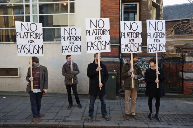 Protesters gather outside Cambridge University's Student Union holding banners reading 'No platform for fascism'